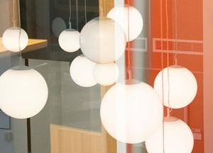 Round globe light pendants hanging from ceiling of Butler Library